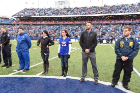 UBMD Emergency Medicine physicians Brian Clemency (2nd from left) and Zach Downs (2nd from right) on the field at New Era Field for First Responders' Day, courtesy of the Buffalo Bills.
