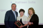 Margarita L. Dubocovich, PhD (right), and Michael E. Cain, MD, presented Kim Griswold, MD, with an Excellence Through Inclusion and Cultural Enhancement Award.