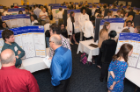 High school students exhibited scientific posters describing their studies of online gene annotation. The event was part of a UB project that aims to inspire them to pursue careers in the science, technology, engineering and math fields.