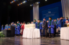 The 143 medical degree diplomas are center stage at the beginning of the 170th annual commencement of the Jacobs School of Medicine and Biomedical Sciences April 29 at the Center for the Arts.