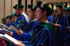 Allen Chung and his fellow classmates recite the Charge of Maimonides during the 170th annual commencement of the Jacobs School of Medicine and Biomedical Sciences.