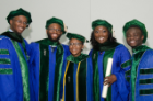 From left, Michael Williams, Okari Owate, Janelle Duah, Chinelo Ogbudinkpa and Prince Bonsu gather to celebrate and congratulate each other following the commencement exercises.