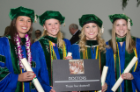 From left, Lauren Jepson, Michele Smith, Chelsey Ciambella and Sarah Riley take a moment to commemorate their official distinction as doctors following the commencement exercises.