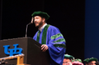 "Student speaker Jason Edwards mixed humor with passion as he spoke about his journey through medical school as the ""last member of the class."""