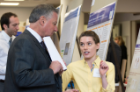 Kaci Schiavone shares her research on shoulder arthoplasty with Michael E. Cain, MD, dean of the Jacobs School of Medicine and Biomedical Sciences.