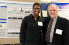 Shante White shares research findings with Anthony A. Campagnari, PhD, senior associate dean for research and graduate education.