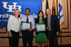 Abhishek C. Sawant, MD, MPH, cardiovascular disease fellow (second from left), and Aishwarya Bharadwaj, MD (second from right), internal medicine resident, receive their oral presentation awards for best clinical research from Anne B. Curtis, MD (left), and Jeffrey M. Lackner, PsyD (right).