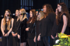 The Royal Pitches perform the national anthem at the biomedical sciences commencement ceremony at the Center for the Arts.