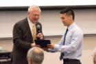 John E. Tomaszewski, MD, presents the Kornel Terplan Award to Charles Zhang, Class of 2020. The award goes to the student with the highest average in pathology.