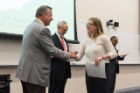 Natalia Crenesse-Cozien is congratulated by Michael E. Cain, MD, after receiving her Dean's Letter of Commendation.