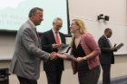 Sara Diletti is congratulated by Michael E. Cain, MD, left, after getting her Dean's Letter of Commendation. David A. Milling, MD, right, announced the honorees and Alan J. Lesse, MD, second from left, handed out the honors.