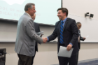 Thomas Fiorica is congratulated by Michael E. Cain, MD, after receiving his Dean's Letter of Commendation.
