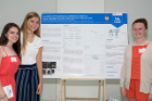 From left, Amherst High School students Natalie Miller, Isabel Steimle and Tessa Decicco with their research poster presentation.