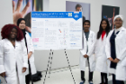 Students from the Research Laboratory High School for Bioinformatics & Life Sciences in Buffalo with their research poster.