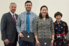 Andrew Baumgartner and Emily Zhou were the recipients of the Adelaide and Brendan Griswold Scholarship given to those who show promise and strong interest in becoming a family medicine or primary care physician. At left is Michael E. Cain, MD, and at right is Kim Strong Griswold, MD.