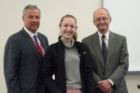 Emily Ellmann received the Edward L. Curvish, MD, Award for Excellence in Biochemistry. Presenting the award were Mark R. O'Brian, PhD, right, and Michael E. Cain, MD.