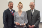 Rachel Knapp received the Edward L. Curvish, MD, Award for Excellence in Biochemistry. Presenting the award were Mark R. O'Brian, PhD, right, and Michael E. Cain, MD.