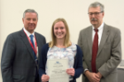 Sarah Quinn received the Anthony Postoloff Scholarship Award in Pathology from Richard T. Cheney, MD, right, and Michael E. Cain, MD. The scholarship is awarded to a third-year student who intends to pursue a career in pathology.