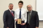 Nico Shary was given the Ernest Witebsky Award for achieving the highest grades in microbiology and immunology. Presenting were Michael E. Cain, MD, left, and Terry D. Connell, PhD.