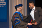 Kerri Damion Pryce, PhD '18, receives the Dennis Higgins Award for PhD Dissertation Research in Pharmacology and Toxicology from his mentor, Arin Bhattacharjee, PhD.