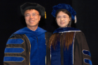 Doctoral graduate Xue Wang poses with her mentor, Jun Qu, PhD.