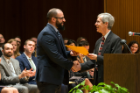 Award winner Russell John Pizzo, left, receives congratulations from Christopher S. Cohan, PhD.