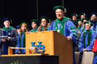 Michael E. Cain, MD, vice president for health sciences and dean of the medical school, speaks during the 173rd annual Jacobs School of Medicine and Biomedical Sciences commencement May 3 at the Center for the Arts.
