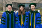 New doctors, from left, Alexander Clark, Sarah Sonenberg and Andrew Knapp smile outside the Center for the Arts following commencement.