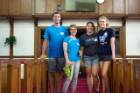 "Cleaning up the interior of the Macedonia Baptist Church was on the day's ""to do"" list for medical students, from left, Quinn Magiera, Lorna Krabill, Alina Gandrabur and Meghan Long."