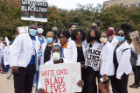 "More than 250 medical students, residents, faculty, staff and other health care workers attended the ""White Coats 4 Black Lives"" march."