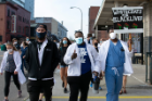 Medical trainees march peacefully down Pearl Street in Buffalo.