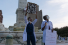 Ashley Jeanlus, MD, right, and LaChaundra Latrice Johnson, MD, left, talk to the marchers.