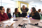 Lauren Kuwik (third from left), clinical instructor in the Department of Medicine, talks with Brianna Morrissey (right).