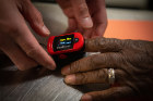 "Among the health screenings that students conducted was a pulse oximetry, performed with the device shown here, called a ""pulse ox,"" that measures the amount of oxygen in a person's blood."
