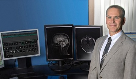 David Hojnacki, MD, and computer displays of neurological images.