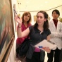 Group of medical students looking at a painting in an art gallery.