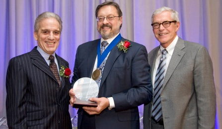 Mark Lema, MD, PhD, receiving award from SUNY Downstate medical school president.