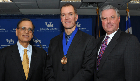UB President Satish K. Tripathi with Leslie J. Bisson, MD, and Michael E. Cain, MD.