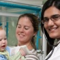 Pediatrics Resident Maliha Rehman and a young patient.