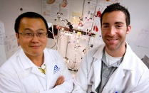 Ji Li, PhD and Alex Morrison-Nozik in front of a perfusion apparatus.